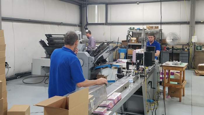 Flottman Company's new folding machine is faster and more accurate.