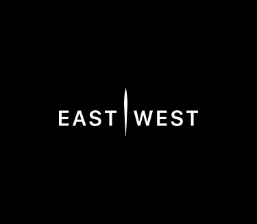 East & West Inc Logo